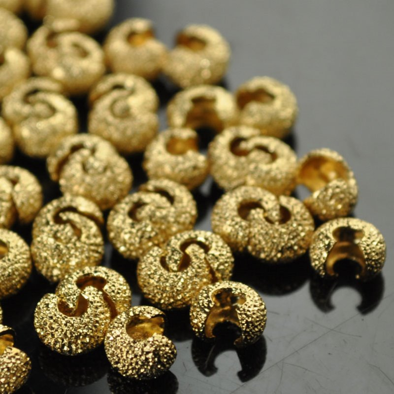24002011 Findings - Crimps - 4 mm Stardust Crimp Covers - Bright Gold Plated (100)