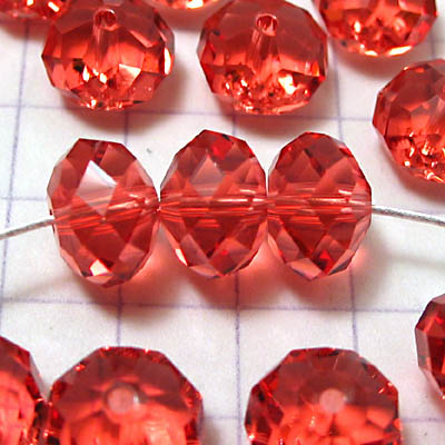 27750401026542 Swarovski Bead - 8 mm Faceted Donut (5040) - Padparadscha (1)