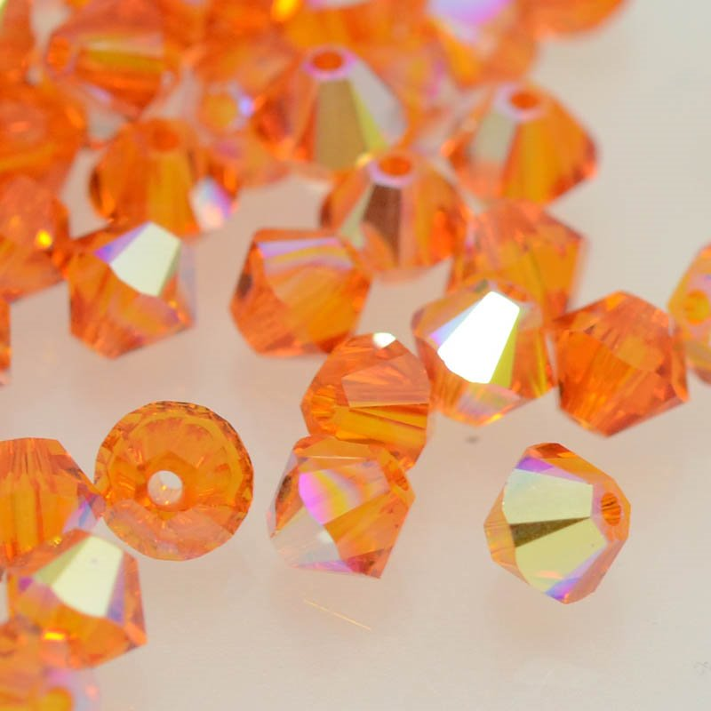 27753011433259 Swarovski Bead - 4 mm Faceted Bicone (5301) - Tangerine AB (36)