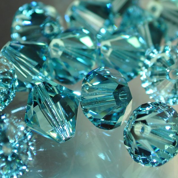 27753012569263 Swarovski Elements Bead - 10 mm Faceted Xilion Bicone (5328) - Light Turquoise (1)