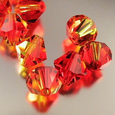 27753018mmfop Swarovski Bead - 8 mm Faceted Bicone (5301) - Fire Opal (1)