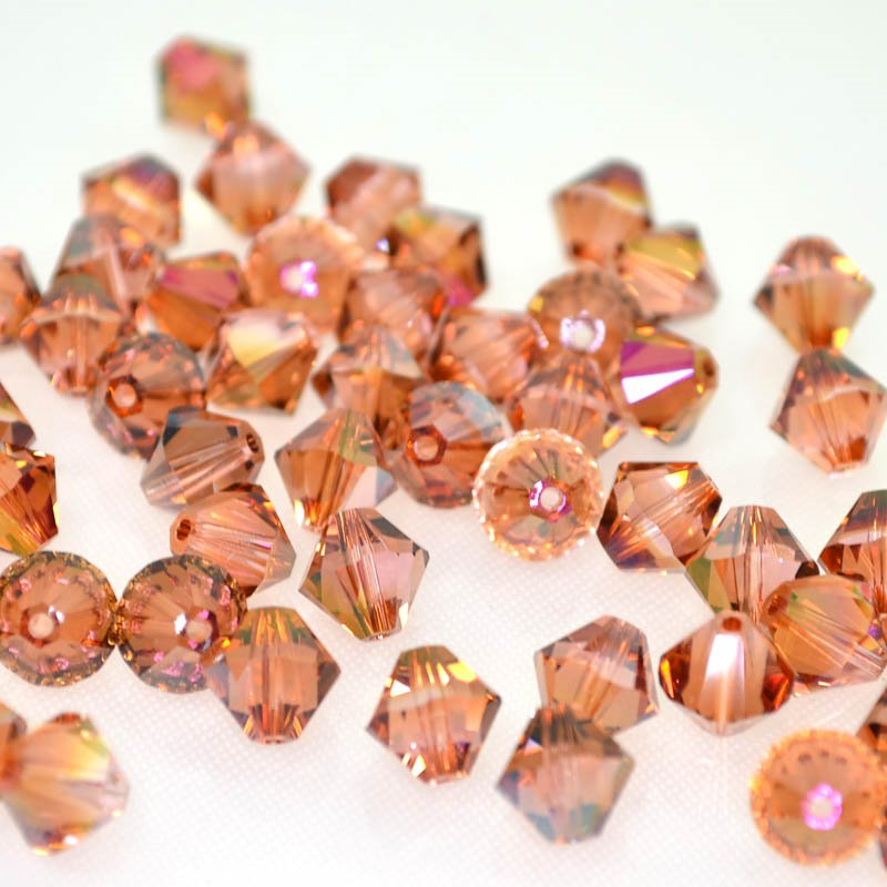 2775301s41247 Swarovski Bead - 8 mm Faceted Xilion Bicone (5328) - Light Rose Mahogany (1)