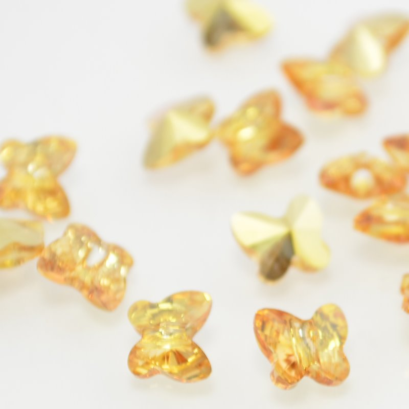 27757546002008 Swarovski Bead - 6 mm Faceted Butterfly (5754) - Crystal Metallic Sunshine (1)