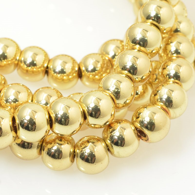 27800107-02 Glass - 6 mm Round - Gold (strand)