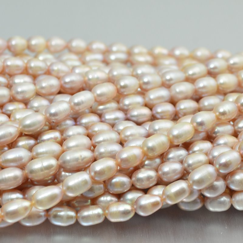s10856 Freshwater Pearls - 6 x 8 mm Oval Pearl - Cream Rose (strand)