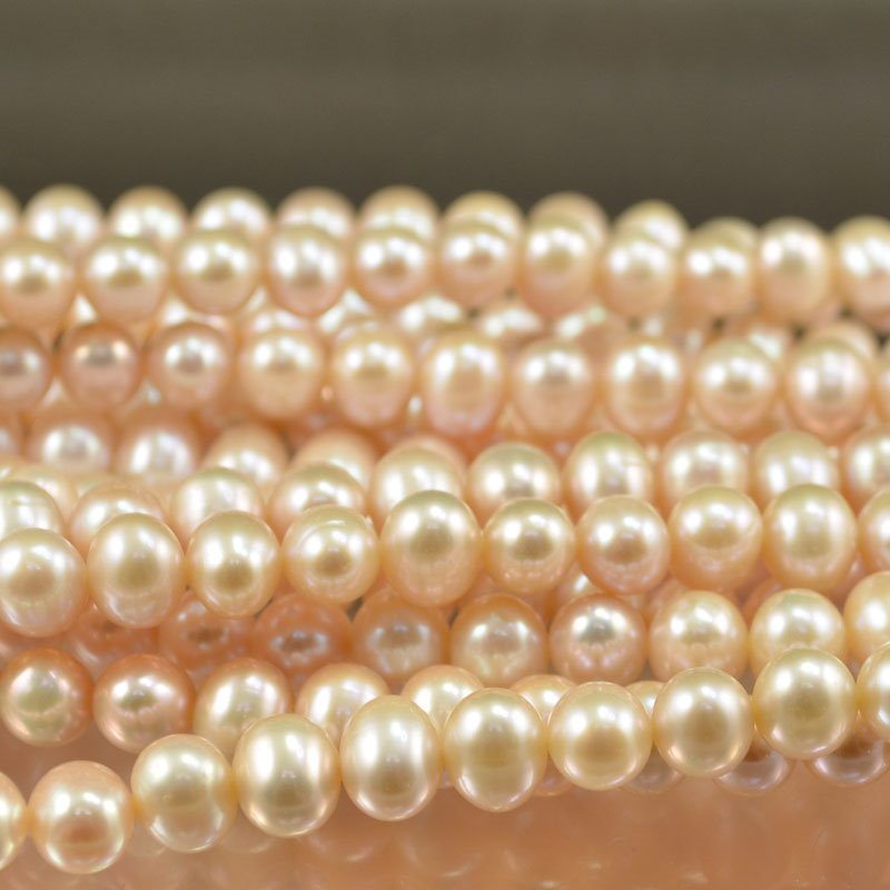 s16035 Freshwater Pearls - 9 mm Near Round Pearl - Pale Pink (strand)