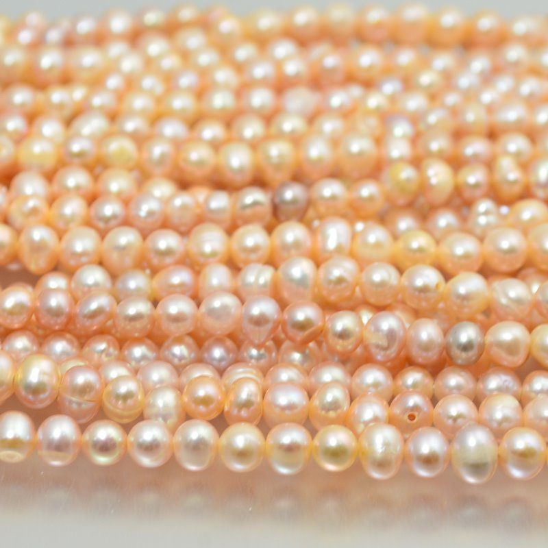s19558 Freshwater Pearls - 6 x 5 mm Near Round Pearl - Cream Rose (strand)