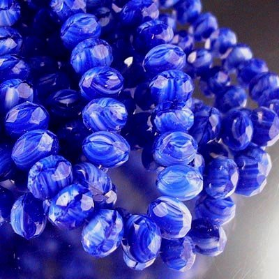 s20301 Firepolish - 8 x 6 mm Faceted Donut - Lapis Givre (strand 25)
