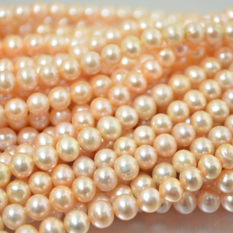 s2237 Freshwater Pearls - 6.5 mm Near Round Pearl - Peach Pearl (strand)