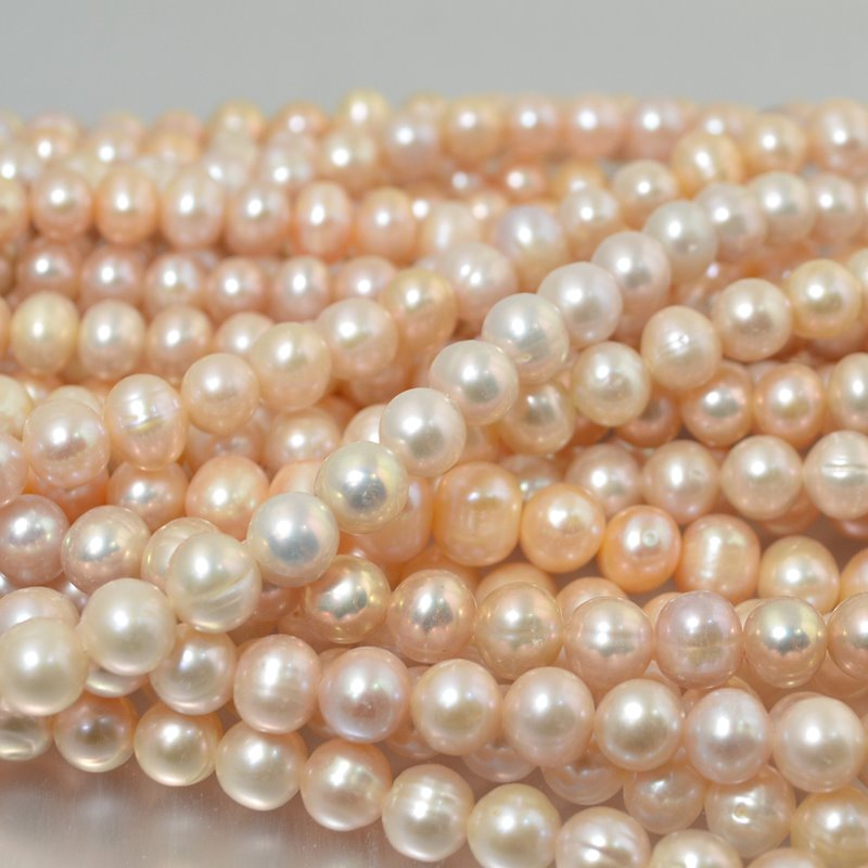 s2248 Freshwater Pearls - 8 mm Near Round Pearl - Multi Peach (strand)