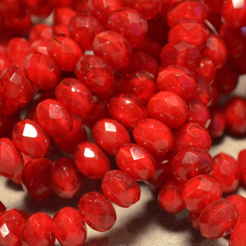 s35939 Firepolish - 9 x 6 mm Faceted Donut - Cherries Jubilee (strand 25)
