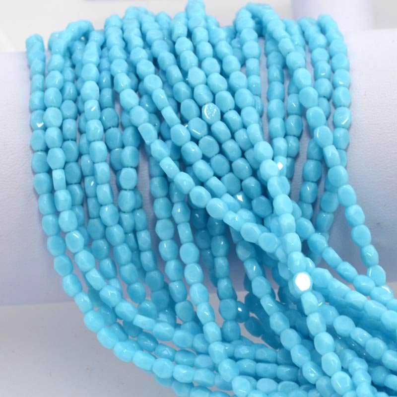 s37738 Firepolish - 4 mm Faceted Windows - Turquoise Blue (strand 50)