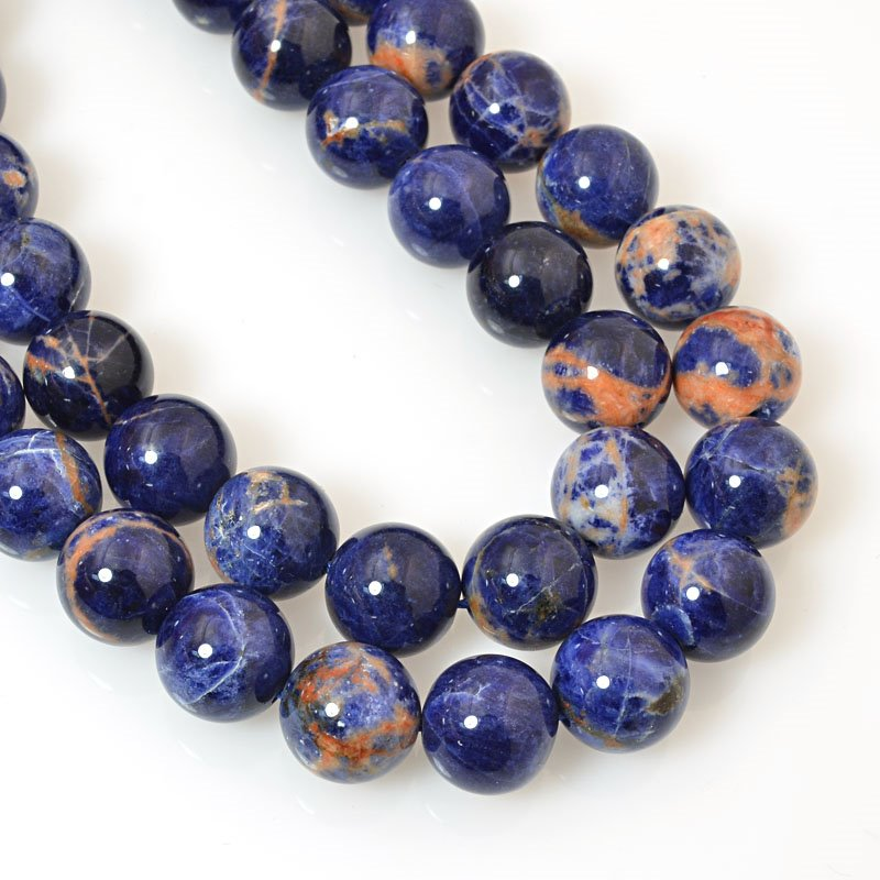 s39669 Stone Beads - 10 mm Round - Orange Sodalite (strand)