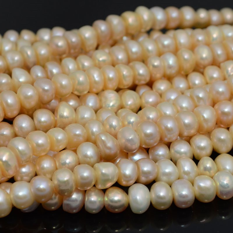 s39892 Freshwater Pearls - 8 x 5 mm Button Pearl - Peach (strand)