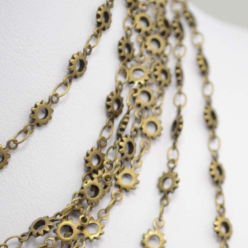 s40265 Chain - 5 mm Sunburst Chain - Antiqued Gold (Inch)