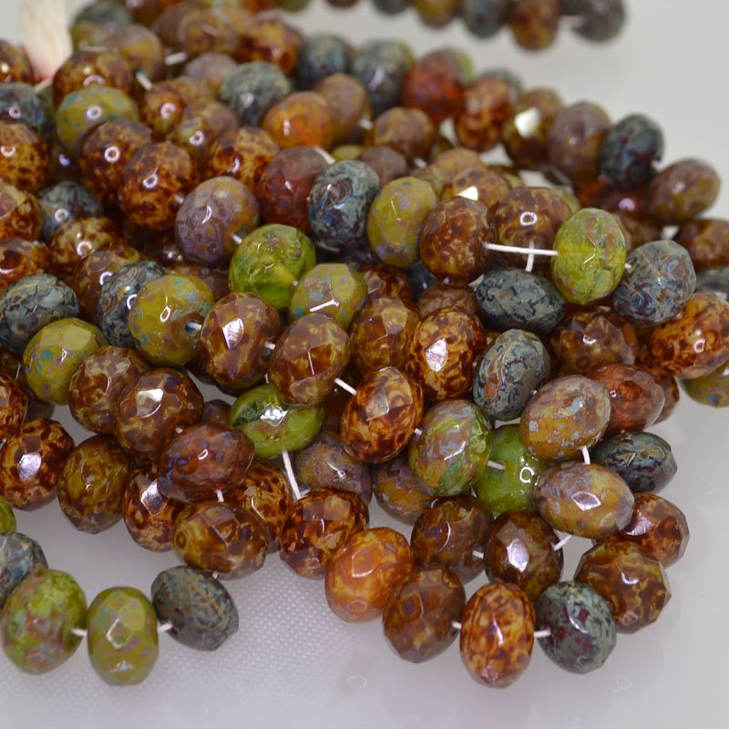 s41996 Firepolish - 9 x 6 mm Faceted Donut - Beraza Forest (strand 25)