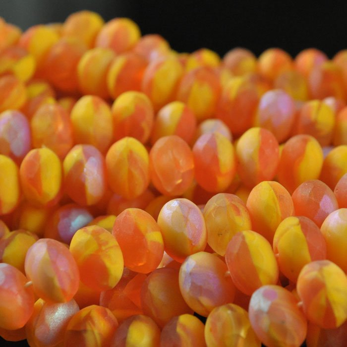s43839 Firepolish - 9 x 6 mm Faceted Donut - Matte Papaya Swirl (strand 25)