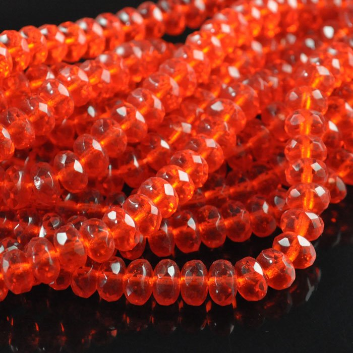 s43842 Firepolish - 7 mm Faceted Donut - Orange Fire (strand 50)