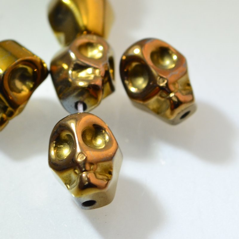 s46664 Stone Beads - 8 x 12 mm Skull - Copper Plated Hematite (1)