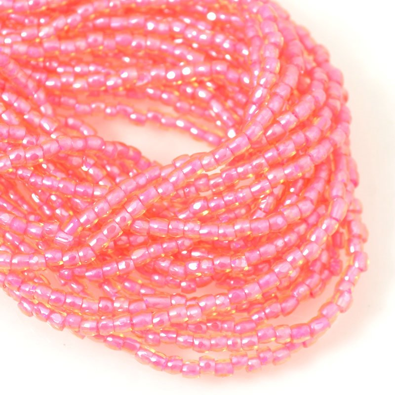 s54627 Czech Seedbeads - 9/0 3-Cut Rocailles - Colour Lined Salmon/Topaz (hank)