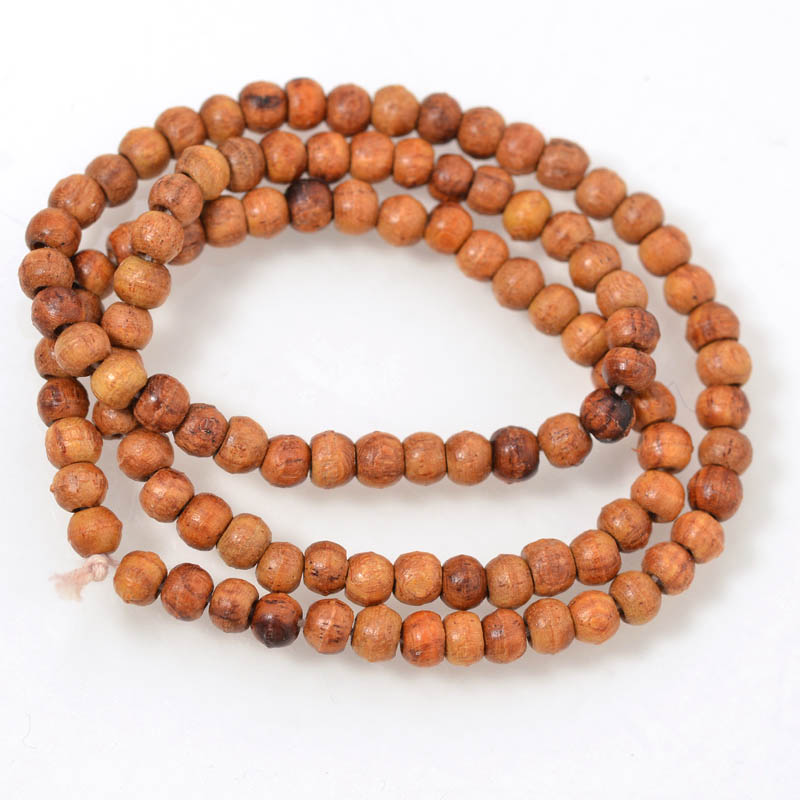 s54923 Wood Beads - 4 mm Near Round - Natural (strand)