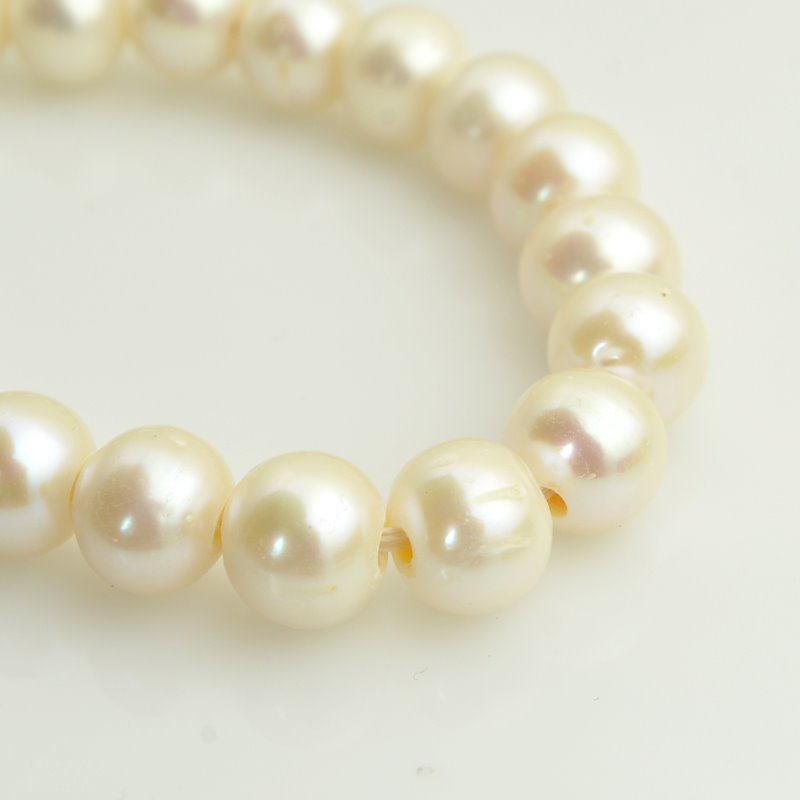 s62581 Freshwater Pearls - 12mm Near Round Pearl - Big Hole - Ivory (strand)