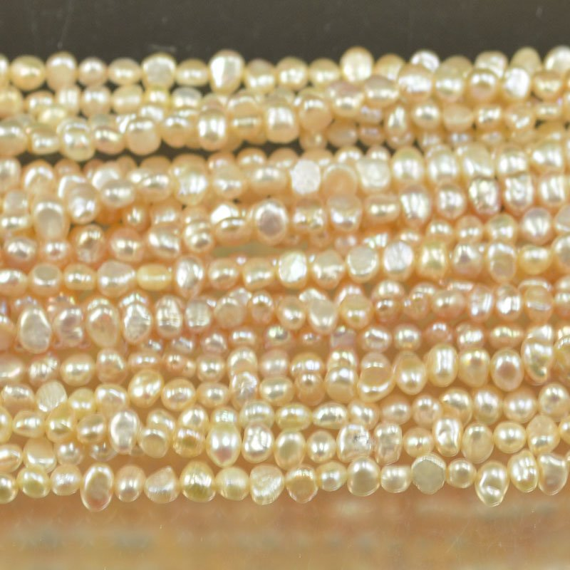 s6717 Freshwater Pearls - 6.5-7 mm Oval / Drop Pearl - Cream (strand)