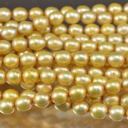 Freshwater Pearls - 9x10mm Oval - Light Gold (strand)