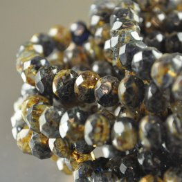 Firepolish - 8x6mm Faceted Donut - Midnight Champagne (strand 25)