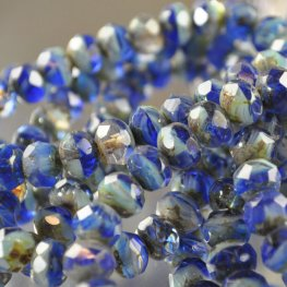 Firepolish - 8x6mm Faceted Donut - Blue Tempest (strand 25)