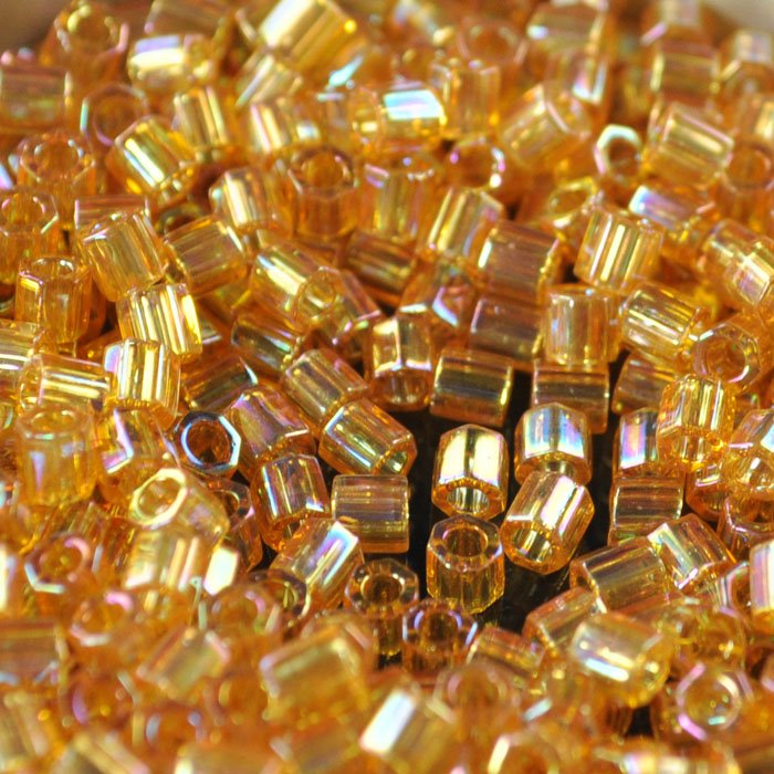 Delicas - 8/0 Japanese Cylinders - Cut - Transparent Light Amber AB (50 g)