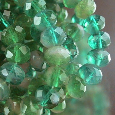 Firepolish - 8x6mm Faceted Donut - Emerald Dawn (strand 25)