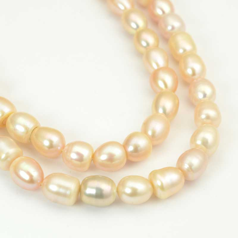 s64033 Freshwater Pearls - 8x7-9mm Irregular Oval Pearl - Cream Pearl (strand)