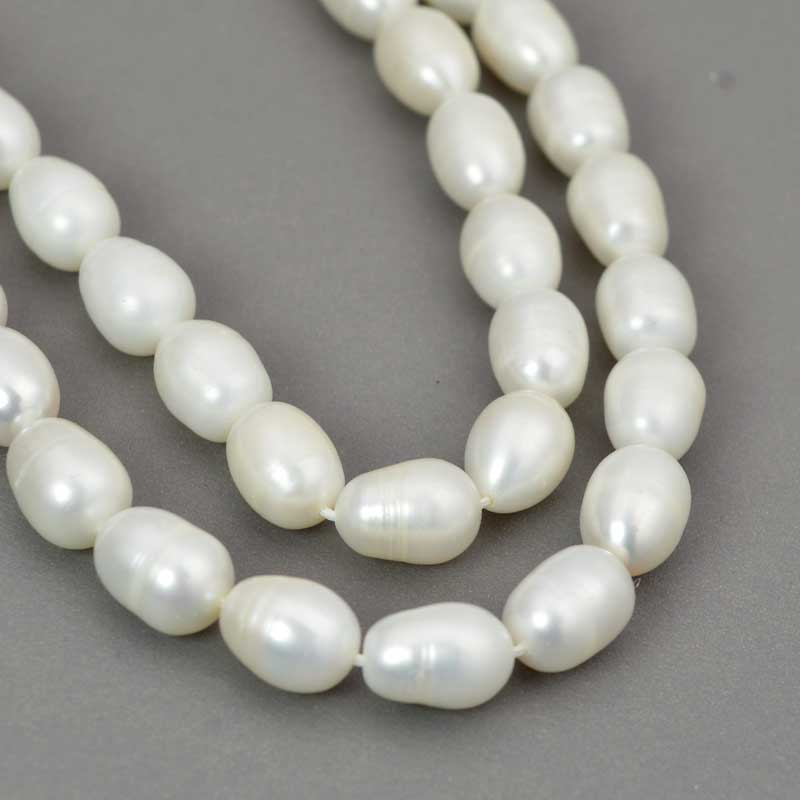 s64051 Freshwater Pearls - 8x10mm Baroque Oval Pearl - White Pearl (strand)